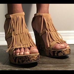 Tan fringed sandals with snake skin inspired wedge